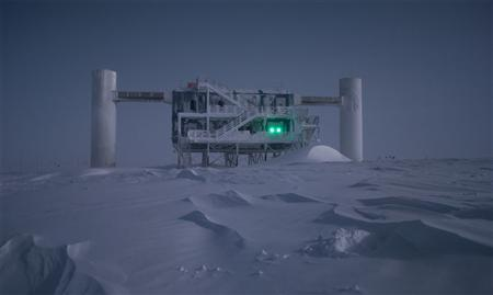 The IceCube lab is illuminated by moonlight in an undated handout photo. Scientists are using the world's biggest telescope, buried deep under the South Pole, to try to unravel the mysteries of tiny particles known as neutrinos, hoping to shed light on how the universe was made. REUTERS/Emanuel Jacobi/NSF/Handout