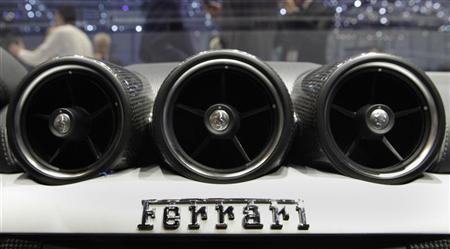 The company's logo is seen in a new Ferrari FF car displayed during the first media day of the 81st Geneva International Motor Show at the Palexpo in Geneva March 1, 2011. REUTERS/Denis Balibouse