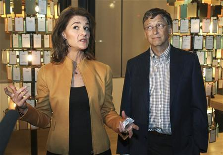 Microsoft co-founder Bill Gates listens while his wife Melinda Gates speaks to the media at an advance tour of the newly constructed $15 million visitor center of the Bill and Melinda Gates Foundation $500 million campus in Seattle, Washington February 1, 2012. REUTERS/Anthony Bolante