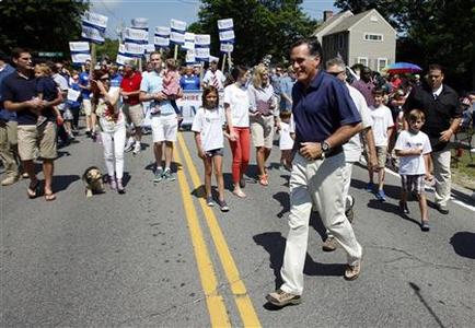 Republican presidential candidate and former Massachusetts Governor Mitt Romney crosses the street as he takes part in the Wolfeboro Fourth of July Parade in Wolfeboro, New Hampshire July 4, 2012. REUTERS/Jessica Rinaldi