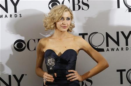 Actress Nina Arianda poses backstage with her award for Best Performance By An Actress in a Leading Role in a Play for her performance in 'Venus in Fur' during the American Theatre Wing's 66th annual Tony Awards in New York June 10, 2012. REUTERS/Andrew Burton