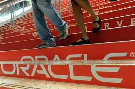 Attendees walk down branded steps at the 29th Oracle OpenWorld in San Francisco October 2, 2011. REUTERS/Susana Bates/Files