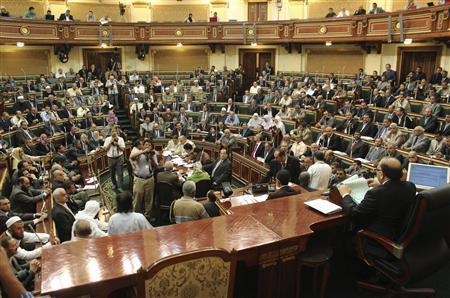 Parliament members talk during a session at the parliament building in Cairo, July 10, 2012. REUTERS/Stringer
