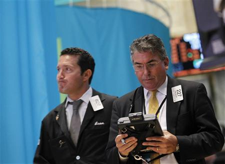 Traders work on the floor of the New York Stock Exchange, July 10, 2012. REUTERS/Brendan McDermid