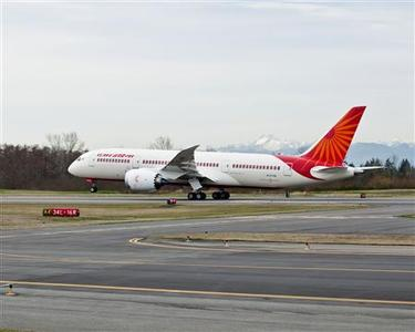A Boeing 787 dreamliner in Air India colours takes off from Paine Field in Everett, WA in this undated handout photo obtained by Reuters July 10, 2012. This image has been supplied by a third party. it is distributed, exactly as received by Reuters. REUTERS/Boeing/Handout