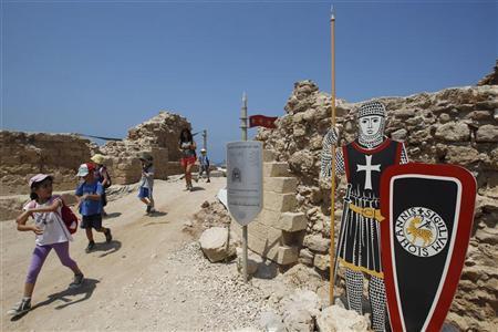 Children leave a Crusader fortress near Herzliya July 9, 2012. REUTERS/Baz Ratner
