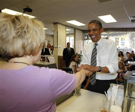 U.S. President Barack Obama buys ice cream at Deb's Ice Cream and Deli in Cedar Rapids, Iowa, July 10, 2012. REUTERS/Jason Reed