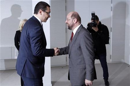 European Parliament President Martin Schulz shakes hands with Romania's Prime Minister Victor Ponta (L) before their meeting at the EU Parliament in Brussels July 11, 2012. REUTERS/Francois Lenoir