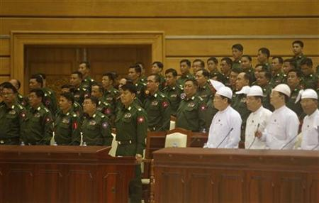 Members of parliament, including those representing the military, attend the opening of the Lower House session in Naypyitaw July 4, 2012. REUTERS/Soe Zeya Tun