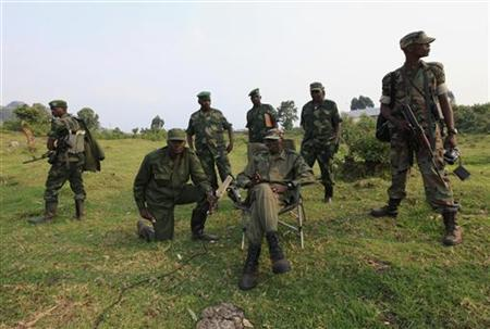 Colonel Sultani Makenga (seated), leader of M23 rebel group, speaks during an interview with Reuters in the eastern DRC town of Bunagana, near the Uganda border, July 8, 2012. REUTERS/James Akena