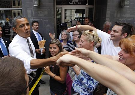 U.S. President Barack Obama greets bystanders after buying ice cream at Deb's Ice Cream and Deli in Cedar Rapids, Iowa, July 10, 2012. REUTERS/Jason Reed