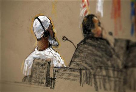 In this photo of a sketch by courtroom artist Janet Hamlin, reviewed by the U.S. military, defendant Ibrahim al-Qosi (L) sits with a member of his defense team inside the courthouse for the U.S. war crimes commission, at the Camp Justice compound, at Guantanamo Bay U.S. Naval Base, Cuba, July 15, 2009. REUTERS/Janet Hamlin/Pool