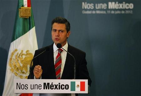 Mexico's President-elect Enrique Pena Nieto speaks as he addresses a news conference in Mexico City July 11, 2012. REUTERS/Tomas Bravo