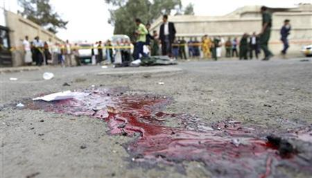 ATTENTION EDITOR - VISUAL COVERAGE OF SCENES OF INJURY OR DEATH The blood and remains of victims are seen are the site of a suicide bombing outside the police academy in Sanaa July 11, 2012. REUTERS/Mohamed al-Sayaghi