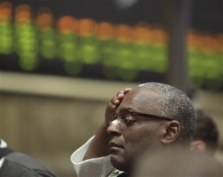 A trader reacts in the Corn Options Pit at the CME group in Chicago July 11, 2012, after the U.S. Department of Agriculture (USDA) updated its crop production, ending stocks and world supply/demand forecast. REUTERS/John Gress