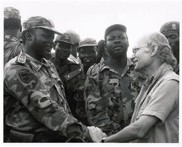 John Garang (L) shakes hands with Roger Winter, now an honorary adviser to the South Sudan government and one of the Council's original members, in this undated image taken in Sudan and provided to Reuters by Roger Winter. Nationhood has many midwives. South Sudan is primarily the creation of its own people. It was southern Sudanese leaders who fought for autonomy, and more than two million southern Sudanese who paid for that freedom with their lives. U.S. President George W. Bush, who set out to end Africa's Longest-running civil war, also played a big role, as did modern-day abolitionists, religious groups, human rights organizations and members of the U.S. Congress. But the most persistent outside force in the creation of the world's newest state was the Council, a tightly knit group never numbering more than seven people, which in the era before email, began gathering regularly at Otello, a restaurant near Washington's DuPont Circle. REUTERS/Handout