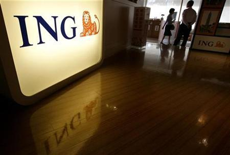People walk in the ING office in Taipei October 20, 2008. REUTERS/Pichi Chuang