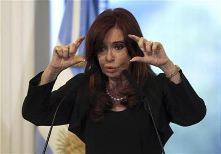 Argentina's President Cristina Fernandez de Kirchner gestures during a ceremony at the Casa Rosada presidential palace in Buenos Aires, April 16, 2012. REUTERS/Stringer