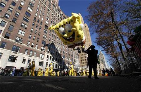 The SpongeBob SquarePants balloon floats down Central Park West during the 85th Macy's Thanksgiving day parade in New York November 24, 2011. REUTERS/Gary Hershorn/Files