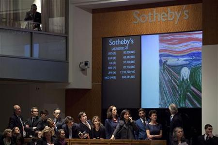 Representatives speak to potential bidders on phones during an auction for Edvard Munch's painting entitled ''The Scream'' at a Sotheby's auction in New York May 2, 2012. REUTERS/Andrew Burton
