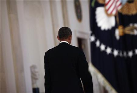 U.S. President Barack Obama walks away after delivering a a statement about the Supreme Court's decision on his Administration's health care law in the East Room of the White House in Washington, June 28, 2012. REUTERS/Luke Sharrett/Pool