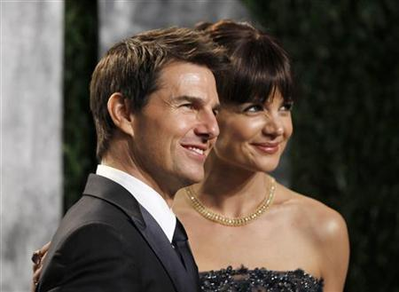 Actor Tom Cruise and his wife, actress Katie Holmes, arrive at the 2012 Vanity Fair Oscar party in West Hollywood, California February 26, 2012. REUTERS/Danny Moloshok