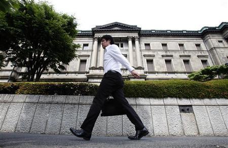 A man walks past the Bank of Japan headquarters in Tokyo June 15, 2012. REUTERS/Yuriko Nakao