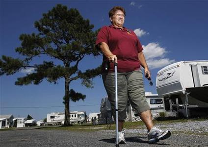 Harriet Bowen, who had hip replacement surgery, walks near her trailer at the Treasure Beach trailer park in Selbyville, Delaware, June 27, 2012. REUTERS/Tim Shaffer