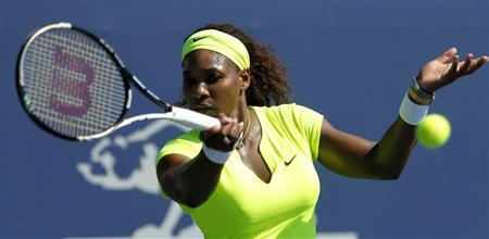 Serena Williams returns a shot against Nicole Gibbs during the Bank of the West Classic women's tennis tournament on the Stanford University campus in Palo Alto, California, July 11, 2012. REUTERS/Robert Galbraith