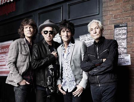 The Rolling Stones' Mick Jagger, Keith Richards, Ronnie Wood and Charlie Watts (L-R) pose in front of The Marquee Club in London in this handout photograph received by Reuters on July 11, 2012. The picture was taken by photographer Rankin to mark the fiftieth anniversary of the Rolling Stones' first ever live performance on July 12, 1962 at the iconic venue on London's Oxford Street. An exhibition of photos from Rolling Stones 50 will be held at London's Somerset House from July 13 to August 27. REUTERS/Rankin/Handout