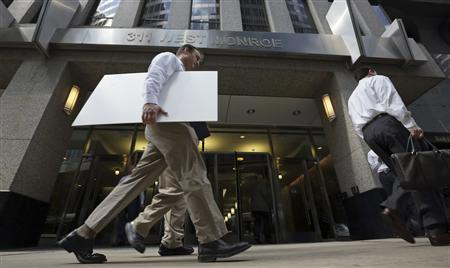 Men walk past the building housing the PFGBest headquarters in Chicago July 11, 2012. REUTERS/John Gress