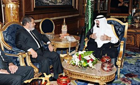 Saudi Arabia's King Abdullah (R) meets with Egypt's President Mohamed Mursi at the Royal Palace in Jeddah airport July 11, 2012. REUTERS/Saudi Press Agency/Handout