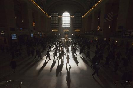 Morning commuters are silhouetted as they walk through the main concourse of the Grand Central Terminal, also known as Grand Central Station, in New York in this March 5, 2012 file photo. REUTERS/Adrees Latif/Files