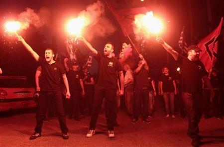 Members of extreme right party Golden Dawn celebrate holding flares in the northern coastal city of Thessaloniki after Greece's general elections June 17, 2012. REUTERS/Grigoris Siamidis