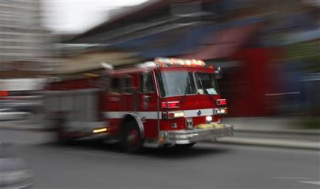 A City of Montreal fire engine responds to a call in downtown Montreal, October 28, 2010. REUTERS/Shaun Best