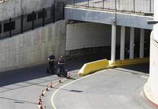 Agents on Segways exit the Detroit-Windsor Tunnel in Detroit, Michigan, July 12, 2012. One of the busiest border crossings between the United States and Canada, the tunnel connecting Detroit with Windsor, Ontario, was shut down for five hours on Thursday following a bomb threat, but nothing suspicious was found, authorities said. Some 29,000 vehicles travel every day through the tunnel, which passes underneath the Detroit River. REUTERS/Jeff Kowalsky