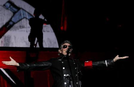 Pink Floyd co-founder Roger Waters performs during ''The Wall'' tour at Monumental stadium in Buenos Aires, March 7, 2012. REUTERS/Marcos Brindicci