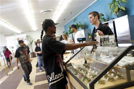 Customers browse the showcases at the Harborside Health Clinic in Oakland, California in this June 30, 2010 file photo. REUTERS/Robert Galbraith/Files