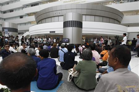 Thai activists listen as the verdict is given at the Constitutional Court in Bangkok July 13, 2012. REUTERS/Sukree Sukplang