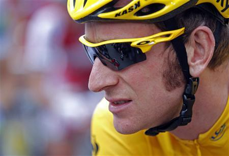 Sky Procycling rider and leader's yellow jersey Bradley Wiggins of Britain awaits before the start of the 12th stage of the 99th Tour de France cycling race between Saint-Jean-de-Maurienne and Annonay-Davezieux, July 13, 2012. REUTERS/Stephane Mahe