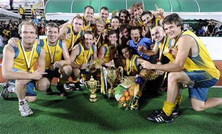 Australia's players celebrate with the trophy after their victory in their final match against Pakistan in the Sultan Azlan Shah Cup hockey tournament in Ipoh, 200km (120 miles) north of Kuala Lumpur, May 15, 2011. REUTERS/Samsul Said/Files