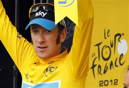 Sky Procycling rider Bradley Wiggins of Britain wears the leader's yellow jersey on the podium after the 12th stage of the 99th Tour de France cycling race between Saint-Jean-de-Maurienne and Annonay-Davezieux, July 13, 2012. REUTERS/Bogdan Cristel