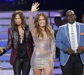 "Judges Steven Tyler (L), Jennifer Lopez and Randy Jackson pose together during the 11th season finale of ""American Idol"" in Los Angeles, California, in this May 23, 2012 file photo. REUTERS/Mario Anzuoni/Files"