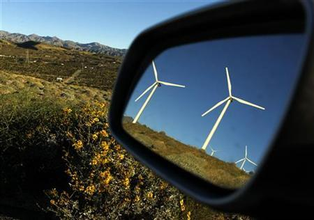 Windmills are reflected in a car mirror at a wind farm in Palm Springs, California, February 9, 2011. California aims to slow climate change by putting a price on carbon -- a low, low starting price. The program is the last, keystone step in a controversial half-decade push to green the state's business for the good of the planet and the economy. Picture taken February 9, 2011. REUTERS/Lucy Nicholson