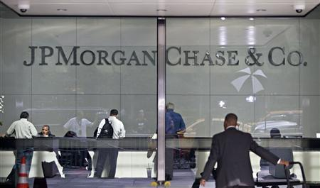 People are seen in the lobby of JP Morgan Chase's international headquarters on Park Avenue in New York July 13, 2012. REUTERS/Andrew Burton