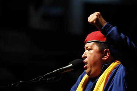 Venezuela's President Hugo Chavez speaks during an election rally in Barcelona in the state of Anzoategui July 12, 2012. REUTERS/Carlos Garcia Rawlins