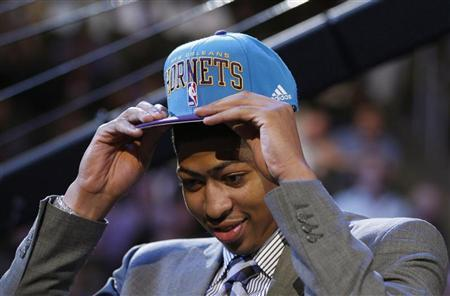 NBA prospect Anthony Davis from the University of Kentucky tries on his cap after being selected by the New Orleans Hornets as the first overall pick in the 2012 NBA Draft in Newark, New Jersey, June 28, 2012. REUTERS/Adam Hunger