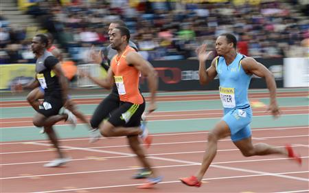 Tyson Gay of the U.S. (2nd R) competes and wins the men's 100m finals during the Diamond League London Grand Prix athletics meet at Crystal Palace in London July 13, 2012. REUTERS/Dylan Martinez