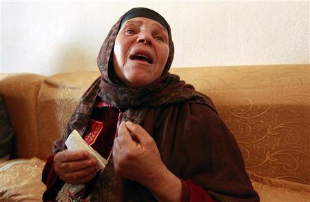 Mannoubiya Bouazizi, mother of Mohamed Bouazizi cries at her home in the Tunisian town of Sidi Bouzid January 19, 2011. REUTERS/Zohra Bensemra