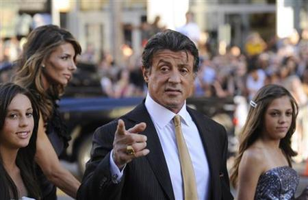 Cast member Sylvester Stallone attends the premiere of the film ''The Expendables'' with his wife Jennifer Flavin (rear) and their daughters Sophia (L) and Sistine (R) in Los Angeles August 3, 2010. REUTERS/Phil McCarten